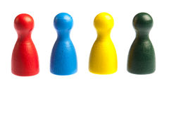 Four diverse pawn game figures Royalty Free Stock Photography