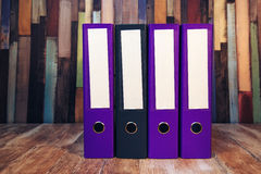 Four document ring binders with blank labels Stock Image