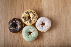 Four donut on table Stock Images