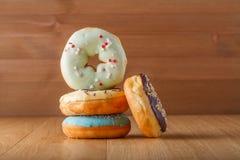 Four donut on table Royalty Free Stock Photos