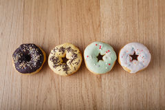Four donuta in row Stock Image