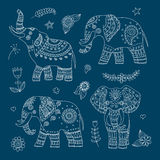 Four doodle vector elephants and floral elements for design Stock Photos