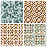 Four dotted seamless patterns with rings, polka dot Stock Photos