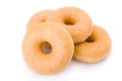 Four doughnuts or donuts piled Stock Photo