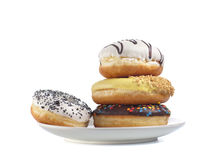 Four doughnuts on a plate  on white Stock Images