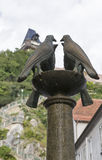 Four dove fountain closeup on Schlossbergplatz in Graz, Austria. Stock Photography