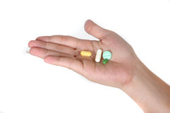 Four drugs. In the palm of the hand isolated on white background Stock Photos