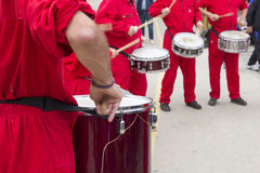 Four drummers. In red overalls drumming on the streets of the city Royalty Free Stock Photo
