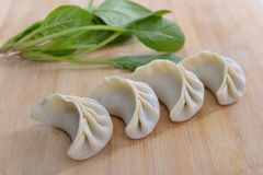 Four dumplings and spinach Stock Images