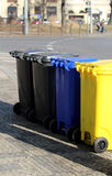 Four dust bins on the street Royalty Free Stock Images