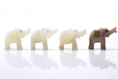 Four dwarf elephant statuettes Stock Photo