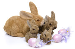 Four easter bunnies in front of eggs Stock Photo