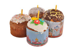 Four easter cakes with candles. Four easter cakes cost on a table Royalty Free Stock Images