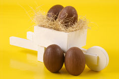 Four Easter eggs and pushcart Royalty Free Stock Photos