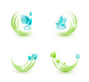 Four ecological icons. Four icons made of plant leaves and water droplets, ecological concept Stock Image