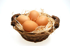 Four eggs in basket Royalty Free Stock Images