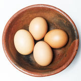 Four eggs in a bowl Stock Photo