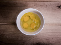 Four eggs in a bowl Stock Photos