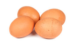 Four eggs closeup. Four eggs on a white background Stock Images