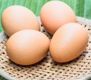 Four eggs. Laid on bamboo woven from banana leaves and placed over one another Royalty Free Stock Photos