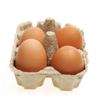 Four eggs in a paper box Royalty Free Stock Images