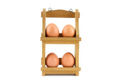 Four eggs in wooden egg rack Stock Photography
