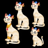 Four Egyptian figurines of white cats Stock Photo