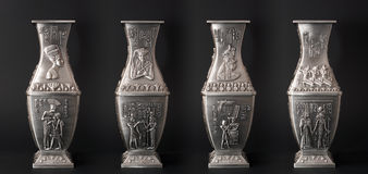 Four egyptian vases. Isolated on black background Stock Photos