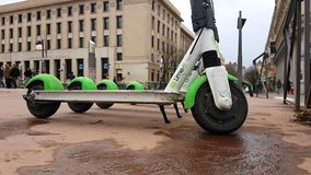 Four Electric Rental Scooter Lime-S Place Bellecour Lyon France. Lyon, France - January 4, 2019: Four Lime-S Electric Rental Scooter Parked On Place Bellecour In stock footage