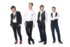Four elegant young men Stock Images