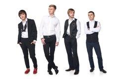 Four elegant young men Stock Images