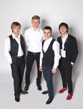 Four elegant young men Stock Photography