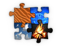 Four elements. Jigsaw puzzle with four elements Earth, sky, fire and water Stock Images