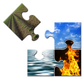 Four elements in a puzzle - Earth apart. Four elements -Earth - Sky - Water - Fire - in a puzzle - Earth apart Stock Photo