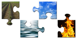 Four elements in a unsolved puzzle. Four elements - Earth - Water - Sky - Fire - in a unsolved puzzle Royalty Free Stock Image