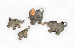 Four elephants from ceramics. On a white background Royalty Free Stock Photo
