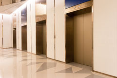 Four elevators in hotel lobby. Stock Photo