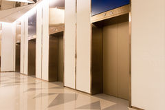 Four elevators in hotel lobby. Royalty Free Stock Image