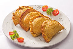 Four empanada on plate Stock Image