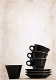 four empty black coffee cups Stock Photography