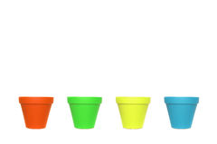 Four empty ceramics flowerpots in a row with different colours Stock Photo