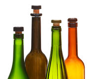 Four empty closed wine bottles close up Royalty Free Stock Photography
