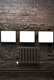 Four empty frames on brick wall Royalty Free Stock Photography