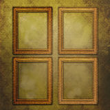 Four empty frames on vintage wallpaper. Four golden frames on a vintage wallpaper with grunge effects Stock Images