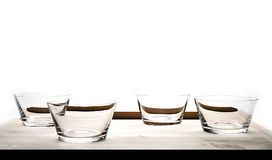 Four empty glass bowls Royalty Free Stock Images