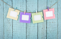 Four empty photo frames hanging with clothespins Stock Photos
