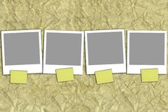 Four empty photographs with yellow notes Stock Photo