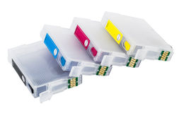 Four empty refillable cartridges for colour inkjet printe Royalty Free Stock Images