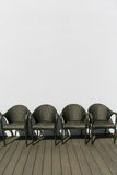 Four Empty Woven Chairs Royalty Free Stock Image