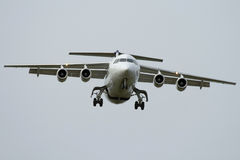 Four-engined airplane. Four-engined jet airplane is landing Royalty Free Stock Image